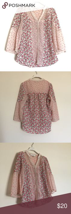 """Lauren Conrad pink white floral button down blouse Lauren Conrad pink white floral button down blouse, excellent condition. Floral printed with peekaboo neckline collar. Pit to pit 18"""", length 25"""". 100% polyester. LC Lauren Conrad Tops Blouses"""