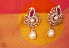 Indian Jewellery and Clothing: Exclusive designs of earrings by Amita damani who is making miracles with rubies,emeralds,sapphires,pearls and diamonds. Gold Jhumka Earrings, Gold Earrings Designs, Gold Diamond Earrings, Gold Jewellery Design, Necklace Designs, Diamond Jewelry, Pearl Earrings, Gold Jewelry Simple, Latest Jewellery