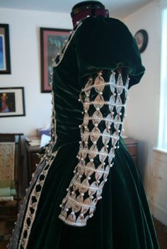 This custom Elizabethan Renaissance dress was created by me, The Very Merry Seamstress. Want to see more? Visit www.verymerryseamstress.com . Don't see what you want? Send me an email with a sketch of what you're looking for. I can make any garment you need - whether it's a wedding gown, faire bodice or a highly-detailed, sculptured costume for a convention.