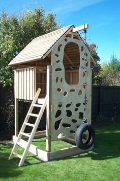 Love this climbing wall...no hand holds to fasten onto and the tire swing/ rope climber.....makes more sense.  Best Selection NZ Made Childrens Playhouse Playhouses