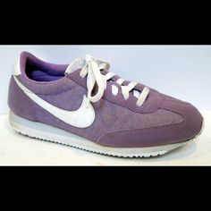 NIKE Women's 'Oceania' Lavendar Sneaker The year 1982 makes a comeback in the Nike Oceania Women's Shoe. Originally created as a running shoe, the Oceania provides the lightweight cushioning you count on and a classic profile you love.  These are in excellent, condition with light soiling on the soles.  Leather and nylon upper Rubber outsole with herringbone pattern for traction and durability EVA foam midsole for cushioning MSRP $75.00 Nike Shoes