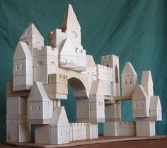 Handcrafted Castle Building Blocks by Peter Dziulak -- forget the kids, I want these for myself! Ok, maybe I'll let the kids play too if they ask nicely. :)