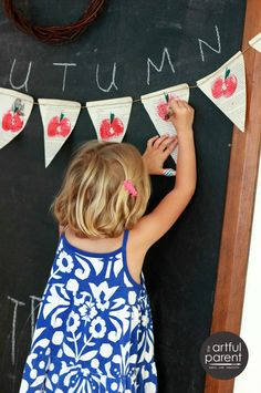 Turn the tradition of printing apples with kids into an awesome fall bunting to decorate your home!