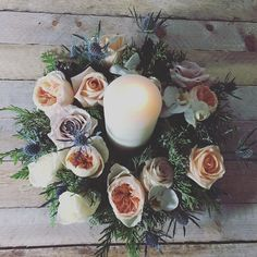 fabulous vancouver florist Warm and romantic #holidaywreath for dining table. #candle #julietgardenrose #thistle #pine #cedar by @gardenpartyflowers  #vancouverflorist #vancouverflorist #vancouverwedding #vancouverweddingdosanddonts