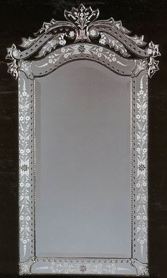 Venetian Mirror, both sides of tv/dresser with chair to side.