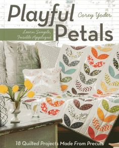 Playful Petals: Learn Simple, Fusible Applique: 18 Quilted Projects Made from Precuts von Corey Yoder, http://www.amazon.de/dp/1607057972/ref=cm_sw_r_pi_dp_IuIQtb1EVX1QQ