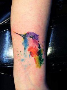 Watercolor Hummingbird Tattoo On Forearm.