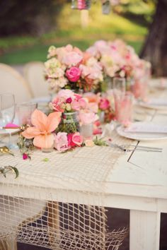 White tables and benches. Shabby chic floral decor. Enchanting.