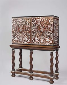 Cabinet of Amalia von Solms, Willem de Rots, c. 1652 - c. 1657. Oak, ivory, ebony, rosewood. H 65 × w 104 × d 40 cm. This cabinet was made for Amalia von Solms, widow of Stadtholder Prince Frederick Henry. -Rijksmuseum Amsterdam- European Furniture, Antique Furniture, Painted Furniture, Cabinet Boxes, Sideboard Cabinet, Furniture Styles, Furniture Design, Furniture Making, Home Furniture