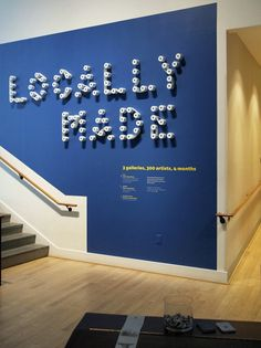 Great exhibit graphics by The Design Office for the RISD Museum using receipt paper rolls.