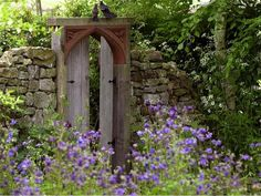 I want one! This is from Roundhill Garden in Sussex, England area, but this would NOT be hard to recreate ... ok maybe a little hard. :/