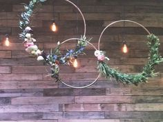 Floral hoops at Summit Women's Conference. Stage lighting and wood wall.
