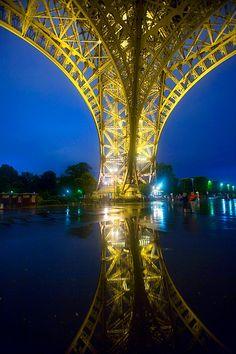 The Eiffel Tower in fog and light rain at twilight, Paris, France
