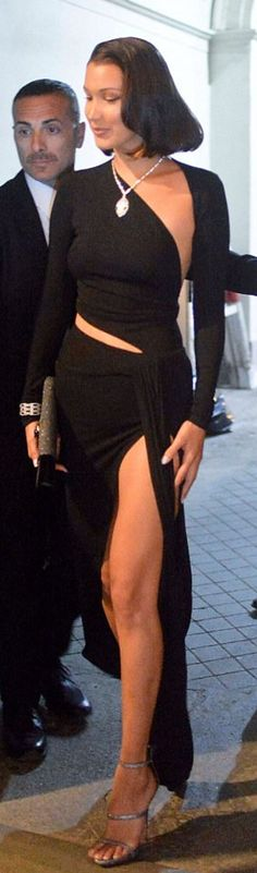 Who made Bella Hadid's black cut out gown and silver sandals?
