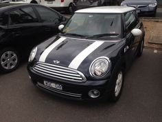 Nice little black Mini Cooper spotted in Camberwell. Standard factory stripes and beautiful leather interior.