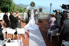 Wedding in Italy on a beautiful terrace high above the sea - The volcanoes of Stromboli and Aetna can be seen off in the  (safe) distance