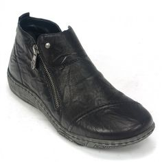Womens leather ankle boots in black color. Soft inside, removable sole and rubber outsole. In large sizes from Remonte.