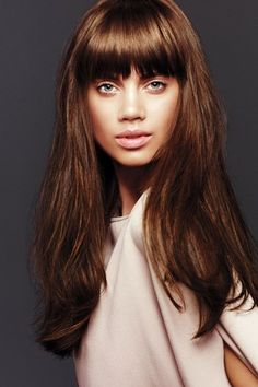 Long layers with sultry eye sweeping bangs never fails to bring the drama.