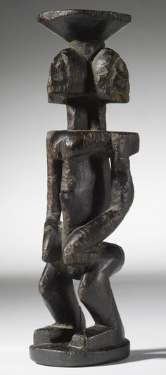 Dogon Four-Headed Figure, Mali | lot | Sotheby's