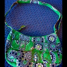 "Vera Bradley Cupcake Green purse! Bundle=20% OFF! Cute Vera Bradley Cupcake Green (Retired January 2009- January 2010) purse! Features two exterior snap pockets, three interior slip pockets, large exterior zipper pocket and full zipper closure. Measures 10"" wide, 6"" high, 4"" deep, and drop strap of 17"" or more or less (strap is adjustable). This purse is overall in good, clean condition. Signs of wear include a few small stains and some light discoloring. Overall, nice! Bundle 2 or more…"