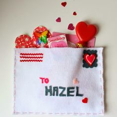 Valentines day or love-related sewn envelope full of goodies