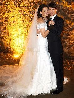 of Katie Holmes & Tom Cruise. Wearing a dress by friend Giorgio Armani & surrounded by A-list friends, Katie Holmes marries Tom cruise in Bracciano, Italy on Nov Celebrity Wedding Photos, Celebrity Wedding Dresses, Celebrity Weddings, Celebrity News, Katie Holmes, Vestidos Armani, Jamie Hince, Most Expensive Wedding Dress, Bridal Gowns