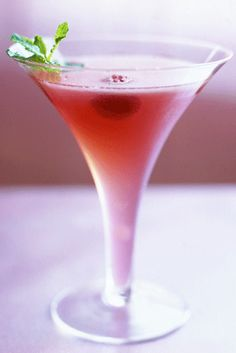 Valentine's Day Cocktails-Sexy Drinks-Very Sexy Martini- Combine the raspberries, mint, lime juice, and simple syrup in a cocktail shaker and muddle. Set the mood this Valentine's Day with sexy drink recipes at redbookmag.com.