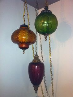 3 Swag lights, hung together. Popular in the and swag lamps are making a comeback. There are lots of amber and green, but I've never seen a amethyst one before. Vintage Lamps, Vintage Lighting, Vintage Home Decor, Vintage Chandelier, 1970s Decor, Swag Light, I Love Lamp, Look Vintage, Retro Home
