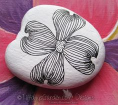 #dogwood #painted #rock.  I painted with acrylic white paint and drew dogwood with fine micron black pen.