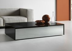 The Gotham coffee table has two drawers and a wireless phone charger pad for easy modern living.