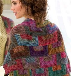 This drop dead gorgeous shawl is a must have for the cold weather season. Beautiful cascading blocks of warm, rustic colors decorate the Amazing Mitered Shawl.