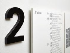 Design of the interior signage system. Several buildings of diverse architectural style and eras compose the Headquarters of the Chamber of Commerce. In view of this, the elements of the signage system are designed to operate in a transversal manner throughout the building, adapting to the different functional needs but at the same time maintaining a character of neutrality and decisive. Client: Camera di Commercio Como Year: 2012 Related projects ...