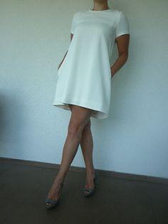 Klasyczna sukienka w kolorze śmietanowym. Pozdrawiam V.gatti