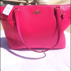 """Host pick Authentic Coach pink purse new with tags **not eligible for bundle discount** Stunning hot pink authentic COACH purse. Brand new with tags attached. Has a gold zipper along with a few other gold embellishments. Inside the purse it's hot pink with 2 compartments and one on the opposite side with a zipper. A coach keychain is attached to the outside. L 13"""" X W 5"""" X H 10"""" HOST PICK 7/7!! Coach Bags Totes"""