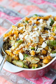 Oven Roasted Butternut Squash & Brussel Sprout Salad with delicious goodies like feta cheese, raisins, and wild rice. Tossed with a balsamic maple dressing!