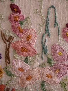 Hollyhocks - detail of a larger piece of vintage embroidery on cushion.