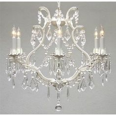 Features:  -It is hardwired.  -Finish: White.  -Material: Wrought iron.  Chandelier Type: -Crystal chandelier.  Finish: -White.  Material: -Metal.  Number of Lights: -6.  Bulb Wattage: -40 Watts.  Bul