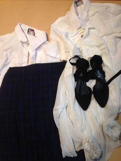 White school shirts, navy & red tartan school skirt, ribbon tie black sort of school shoes