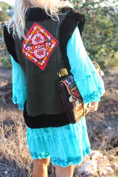 Love and living from Ibiza, amazing leather hippie vests with vintage boho embroidery and fur. www.aurobelle.com