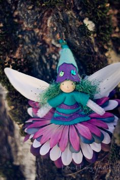 Forest Fairy Crafts fairy made from flowers. Great for Wednesday's woodland fairy birthday party.