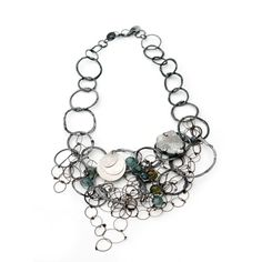 Cluster necklace by Karen Gilbert, oxidized and bright sterling silver, stone beads, quartz crystal. Gallery Lulo.