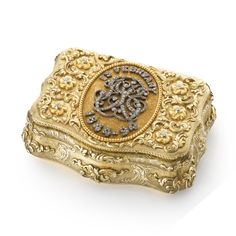 """A German gold and diamond-set presentation snuffbox, maker's mark AM script, late 19th century  shaped rectangular, chased with scrolling foliage on matted grounds, the central oval reserve with diamond-set monogram G&E B?, surrounded by """"15 February 1844-1894""""."""