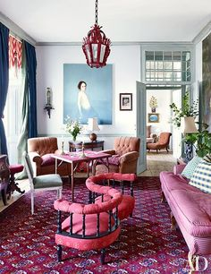 A large canvas by Paulo Damião is mounted above an 18th-century Portuguese demilune table and an Art Deco lamp in the living room | archdigest.com