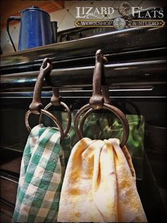 Old rusted snaffle bits to hang handtowels on