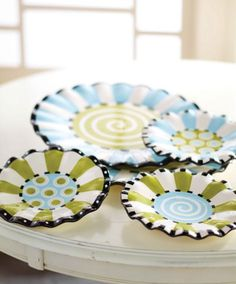 Ruffles Dessert Plates by Mud Pie.. don't have yet