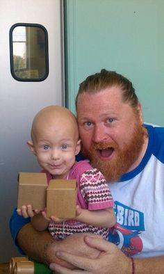 Warrior of Cancer!  Look at the adorable expression on her precious little face.