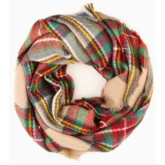A plaid pattern brings a timeless look to this wool blend scarf. Fringed edges.