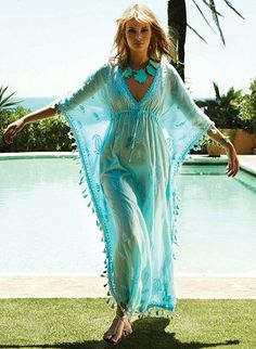 Sky blue long cotton kaftan with empire waist and adjustable drawstring tie under bust.  Kaftan has gorgeous embroidered detail and tassle trim by Melissa Odabash Swimsuits, $366.00