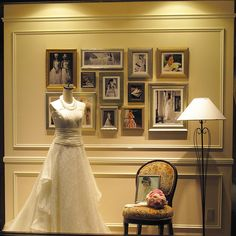 like the idea of wedding photos behind the dress on display in a changing room