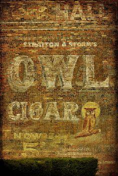 vintage owl cigar ad on building